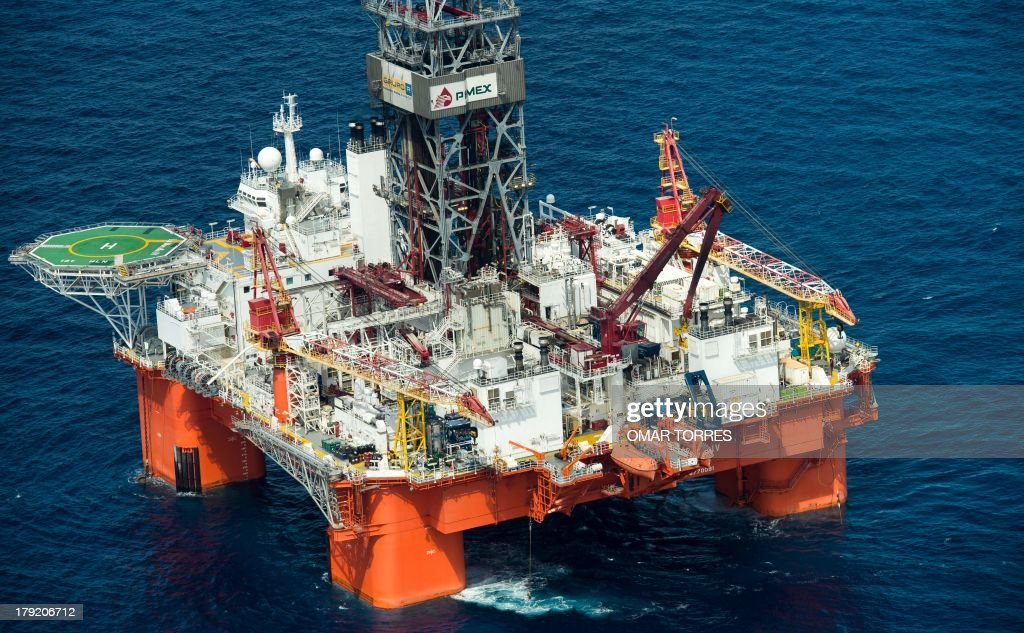 Aerial view of La Muralla IV exploration oil rig, operated by Mexican company 'Grupo R' and working for Mexico's state-owned oil company PEMEX, in the Gulf of Mexico on August 30, 2013. The semisubmersible platform is able to drill to a depth of 10.000 meters in an enviroment such as the Gulf of Mexico. AFP PHOTO/OMAR TORRES