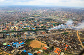 As seen from a plane, the aerial view of Lagos, Nigeria looks like a patchwork quilt of colored roofs, sand, grass and streets.