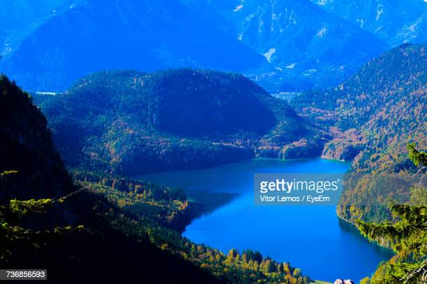 Aerial View Of Lake And Mountains Against Blue Sky