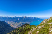 Aerial view of Lake Geneva and Montreux city from the view platform on Rochers-de-Naye, on a sunny summer day in canton of Vaud, Switzerland.
