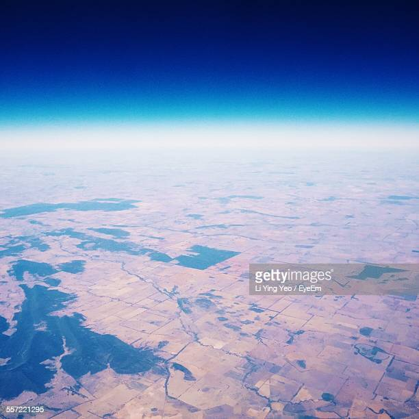 Aerial View Of Landscape Against Clear Blue Sky