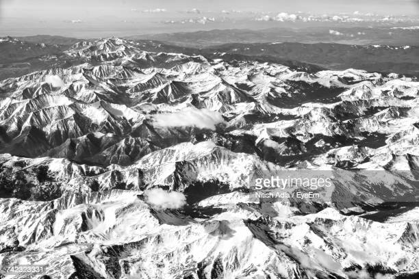 Aerial View Of Landscape And Mountains Against Sky