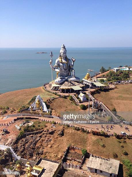 Aerial View Of Large Shiva Statue Against Sea