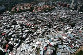 Aerial view of Las Minas shantytown part of Baruta neighbourhood in eastern Caracas taken on February 10 2012 AFP PHOTO/Leo RAMIREZ