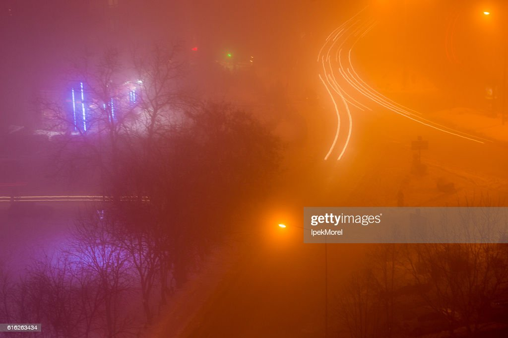 Aerial View of Light Trails on a Foggy Night : Stock Photo