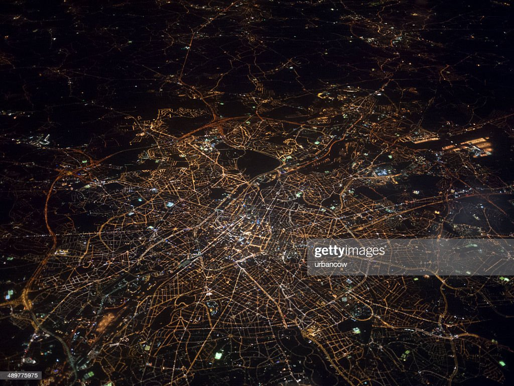 An aerial view of London at night, taken from within an aeroplane
