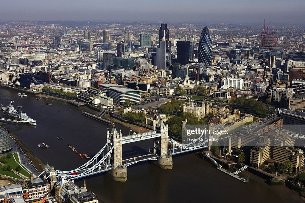 Aerial view of London looking with the Thamesand Tower Bridge in the foreground and the financial district in the background : Stock Photo