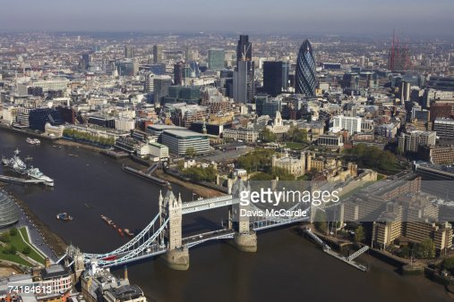 Aerial view of London looking with the Thamesand Tower Bridge in the foreground and the financial district in the background : ストックフォト
