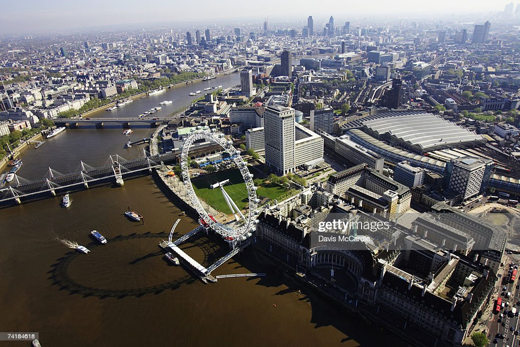 Aerial view of London showing London Eye on the river Thames and Waterloo railway station : Stock Photo
