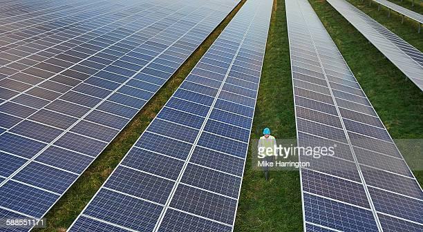 Aerial view of male engineer surveying solar farm