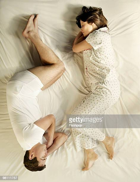 Aerial view of man and woman sleeping