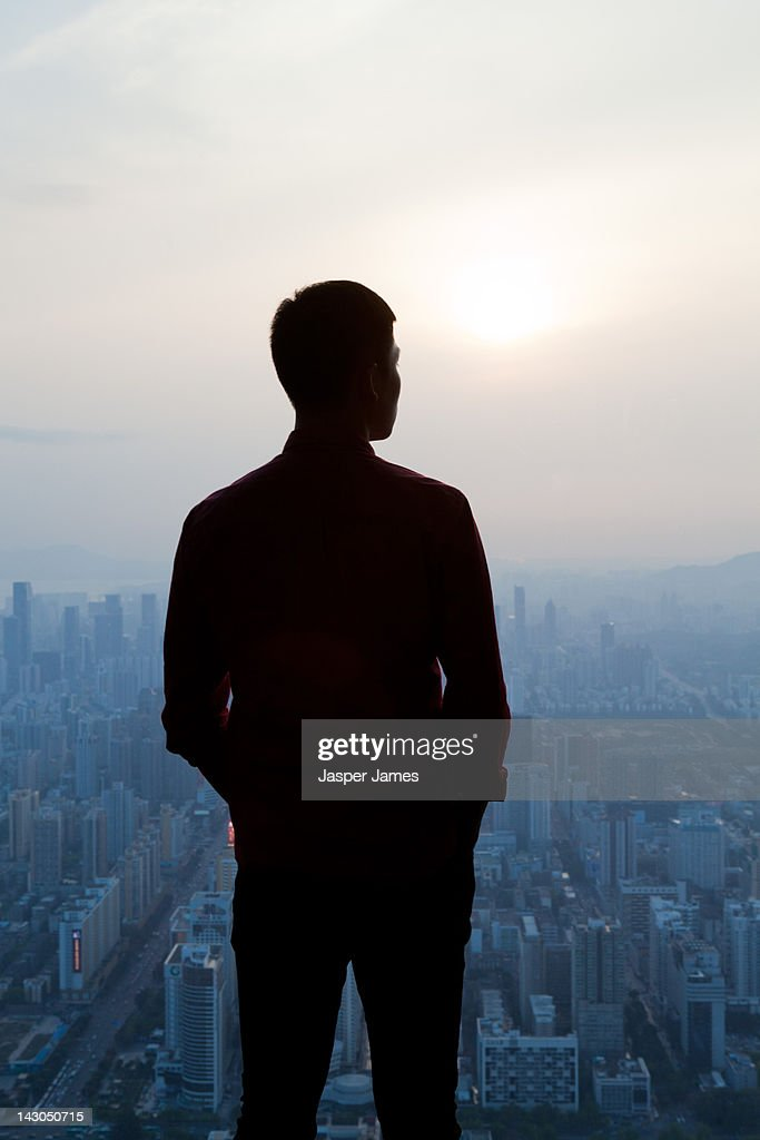 aerial view of man looking out to Shenzen : Stock Photo