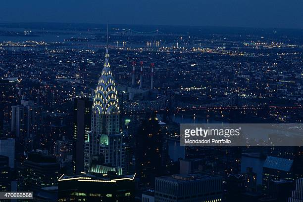 'Aerial view of Manhattan island dominated by the Art Deco spire of the Chrysler Building high skyscraper whose point reminds of a car radiator New...