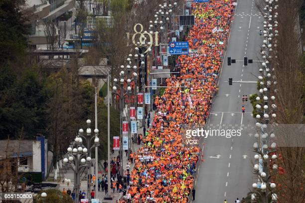Aerial view of marathon runners running along the Yangtze River at Nan Bin Road on March 19 2017 in Chongqing China Chongqing International Marathon...