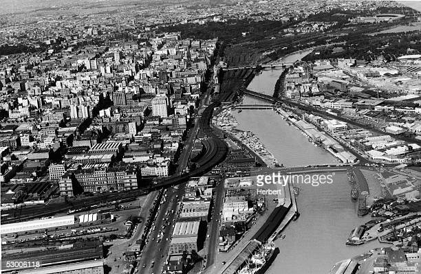Aerial view of Melbourne the capital of Victoria Australia December 1954 Along the banks of the Yarra River to the left is the Flinders Street...