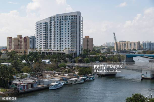 Aerial view of Miami River City marina with docked boats bridges and tall buildings in the Florida city