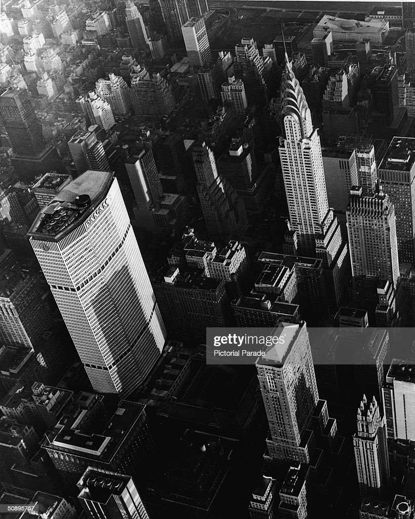 Aerial view of Midtown Manhattan shows the Pan Am Building (lower left), the Chrysler Building (upper right), and the United Nations Secretariat Building (top right), New York City, 1960s.