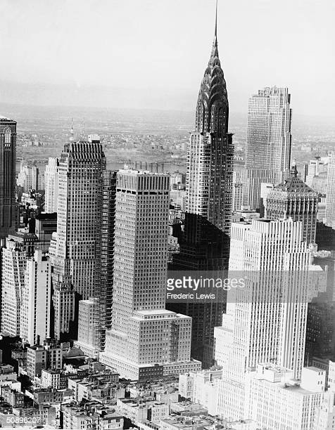 Aerial view of Midtown Manhattan with the Lincoln Building the Chanin Building the SoconyMobil Building the Chrysler Building and the GE Building New...