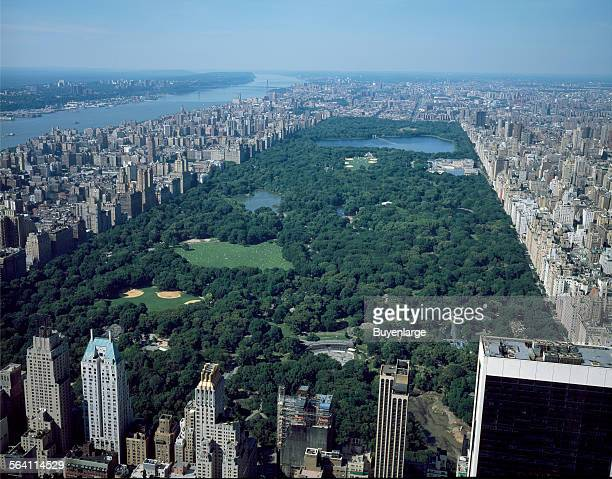 Aerial view of New York City in which Central Park dominates