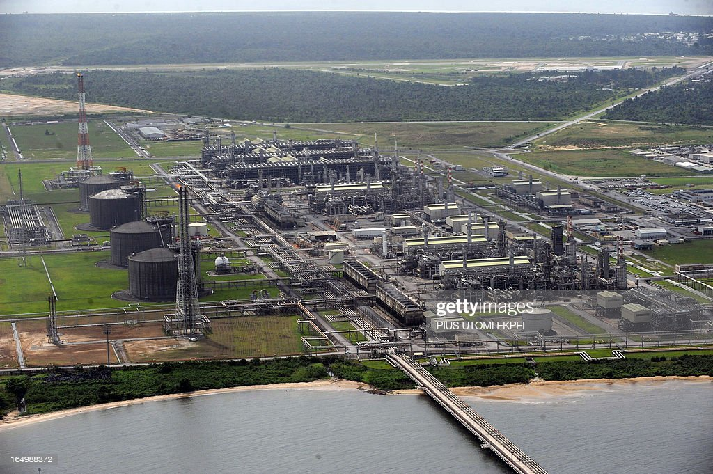 Aerial view of Nigeria Liquefied Natural Gas (NLNG) plant at Bonny Island in Rivers State on March 22, 2013. Shell Petroleum Development Company of Nigeria (SPDC) has threatened to shut down production in April for nine days in the entire Nembe Creek Truck Line (NCTL) to remove a number of bunkering points on pipelines vandalised by oil thieves in the region. 'Whenever we observe a spill, or have a spill on our lines, we shut down production to depressurize and isolate the line, only then can we safely repare our lines because it is then safe to manipulate the line', said Jurgen Jonzen, SPDC corporate pipeline asset manager. Last year, 157 bunkering points were removed and 116 were leaking on the whole SPDC exploitation. Since 2009, SPDC has exprienced an upsurge in vandalisation of pipeline network by criminals causing severe environmental devastation of the region and forcing the company to lose 60 000 barrels daily this year.