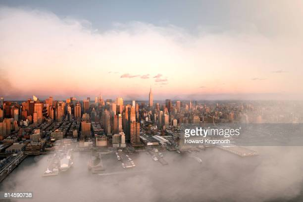 Aerial view of NYC and Hudson River with misty sky