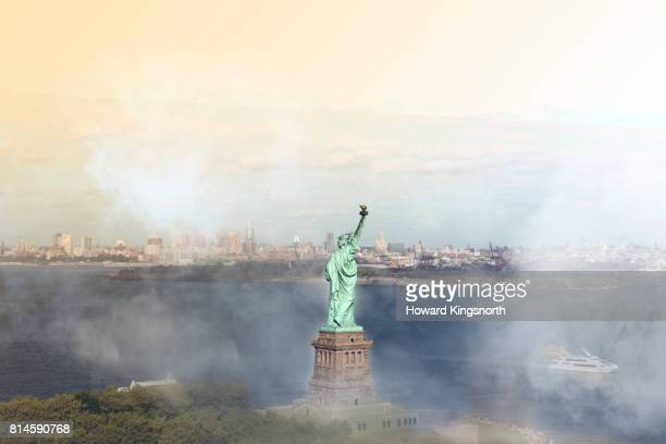 Aerial view of NYC and the Statue of Liberty with misty sky