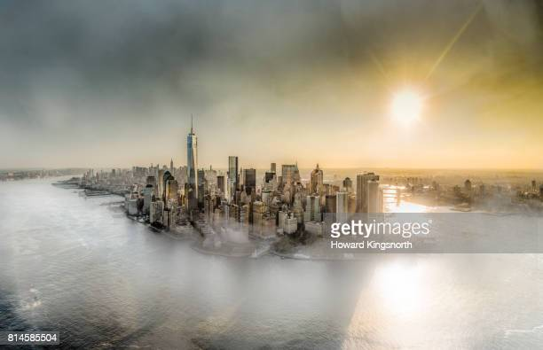 Aerial view of NYC with misty sky, looking north