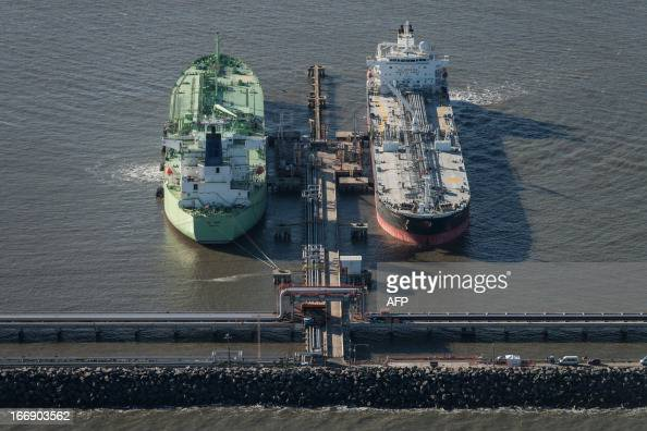 Aerial view of oil tankers docked at the Petrobras' Abreu e Lima oil refinery currently under construction in Recife Pernambuco state Brazil on April...