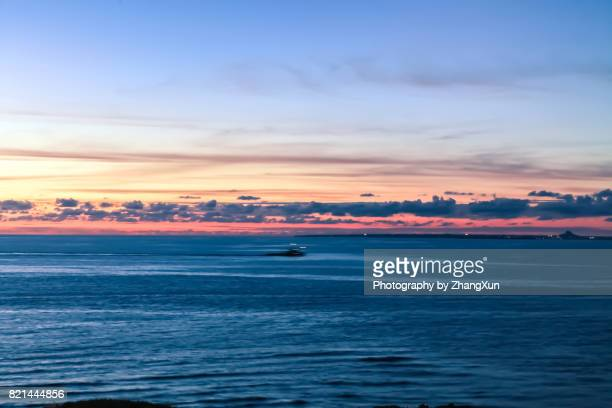 Aerial view of Okinawa with orange color sky and blue sea, at sunset, Manza beach,Naha, Okinawa, Japan.