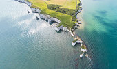 Aerial View of Old Harry Rocks and Purbeck Hills and Dorset coastline on a sunny day.