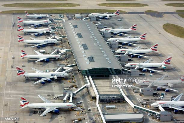 CONTENT] Aerial view of one of Terminal 5 buildings of London Heathrow Airport and Boeing 747 and 777 aircrafts operated by British Airways at the...