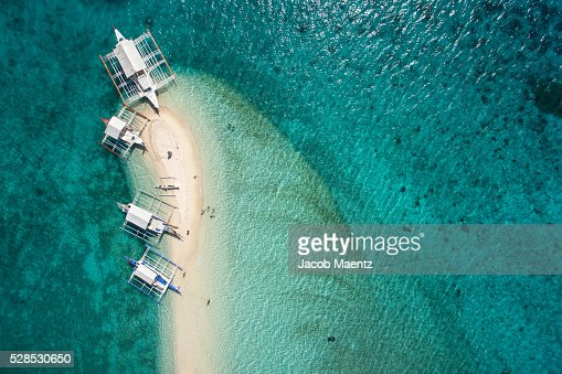 Aerial view of outrigger boats on sand bar
