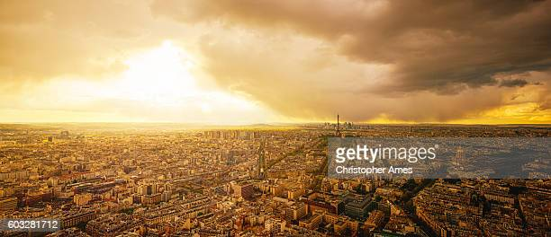 Aerial View of Paris at Sunset with Dramatic Storm Clouds