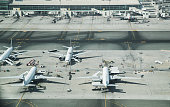 Aerial view of parked airplanes in the airport terminal. Modern and fastest mode of transportation.