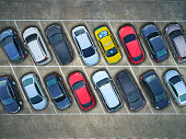 Aerial view of cars in a parking lot.