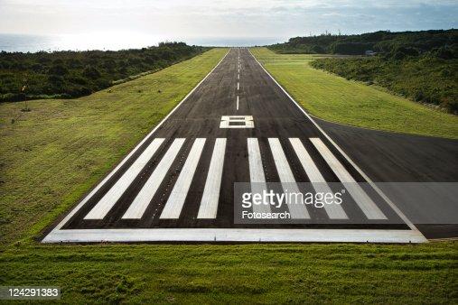 Aerial view of paved airplane runway on Maui, Hawaii.