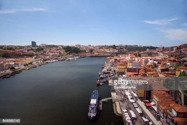 Aerial view of people along the riverbank at Porto, Portugal, taken from Dom Luis I Bridge