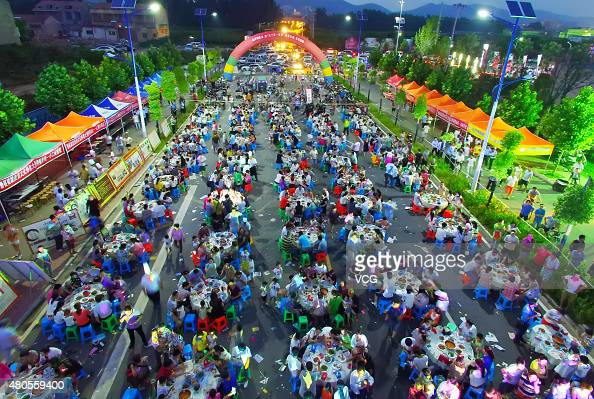 Aerial view of people gathering to eat mutton during a mutton food festival opening on July 11 2015 in Xiaoxian County Suzhou City Anhui Province of...