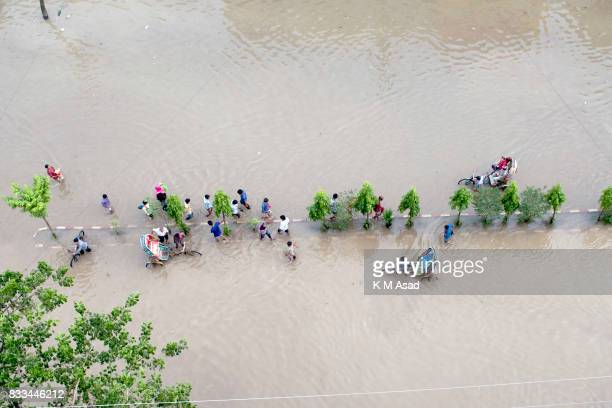 AGRABAD DHAKA CHITTAGONG BANGLADESH Aerial view of people traveling through a flooded area of Chittagong People traveling in flooded areas in...