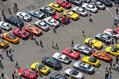 Aerial view of people walking in parking lot