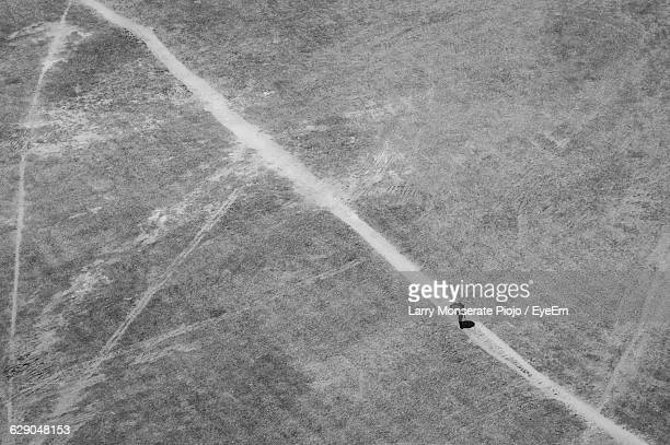 Aerial View Of Person Walking On Track At Field