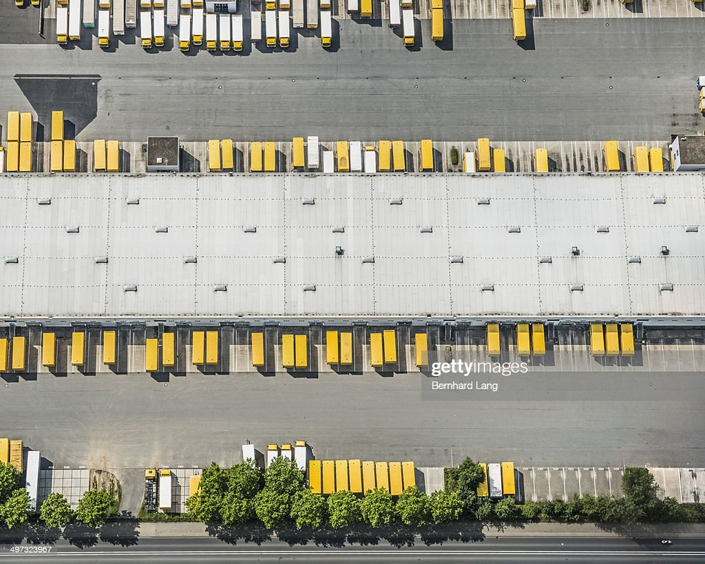 Aerial view of postal trucks and truck trailers : Stock Photo