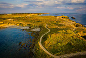 Aerial view of a yellow sunset over Quiberon presquile in France