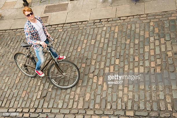 Aerial view of red haired man on bycycle