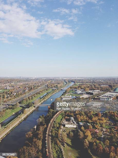 Aerial View Of River Flowing Through City
