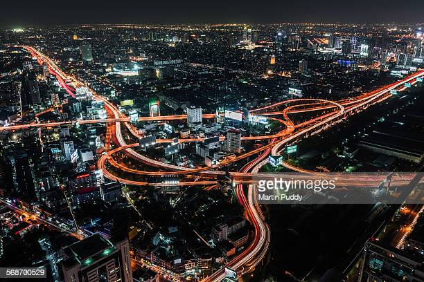 Aerial view of road intersection at night