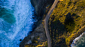 Aerial view of road next to ocean