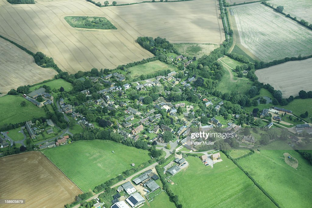 Aerial view of rural town and fields : Stock Photo