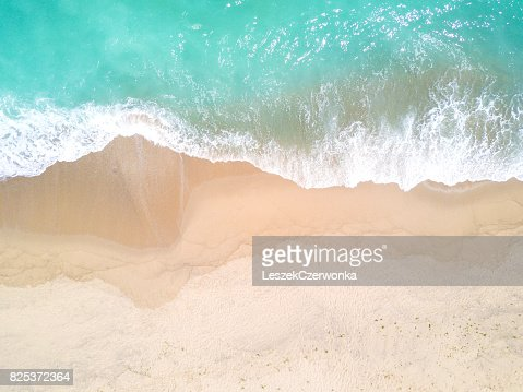 Aerial view of sandy beach and ocean with waves : Stock Photo