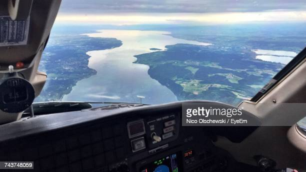 Aerial View Of Sea Seen Through Airplane Window